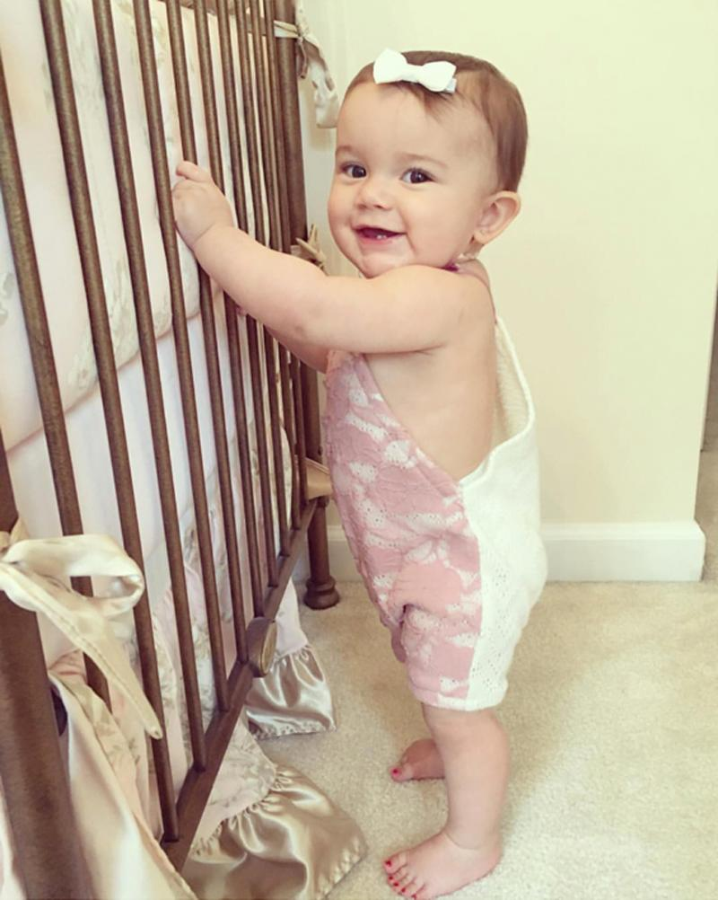 Standing practice with the help of her crib!