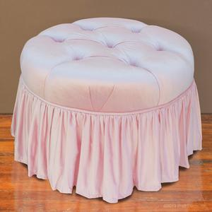 pink tufted ottoman