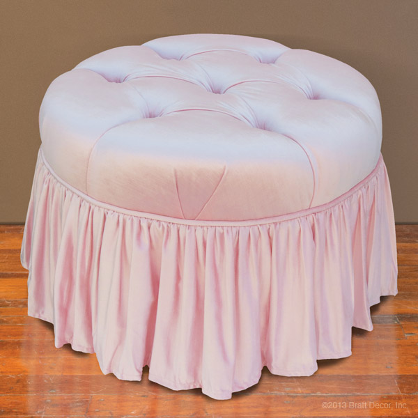 pink tufted glider and ottoman