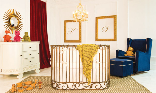 Playful yet smart, this neutral nursery boasts a metallic gold oval crib while adding pops of color throughout just for fun.