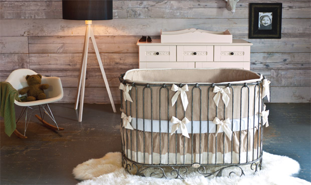 The oval crib is an unexpected choice and wonderfully balances the worn space for a perfect harmony.