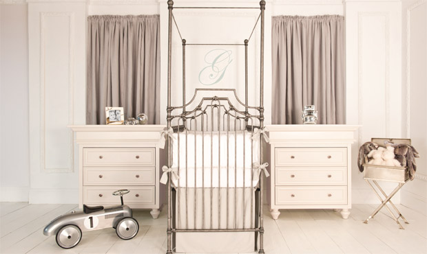 Flanked by twin dressers and dramatic in its scale, the parisian  canopy crib in pewter makes this room especially grand.