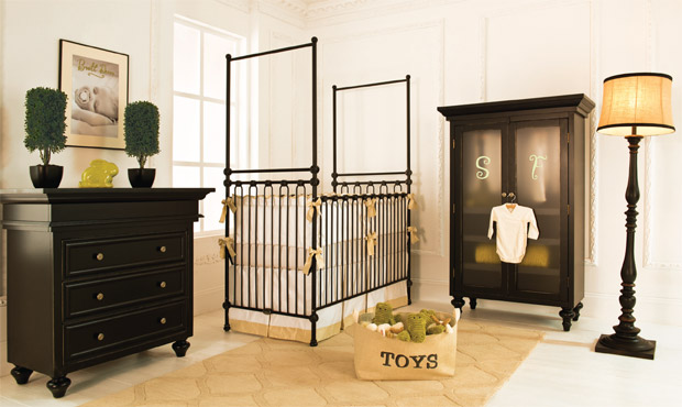 Anchored with a grand four poster crib, this nursery offers modern style and luxury.