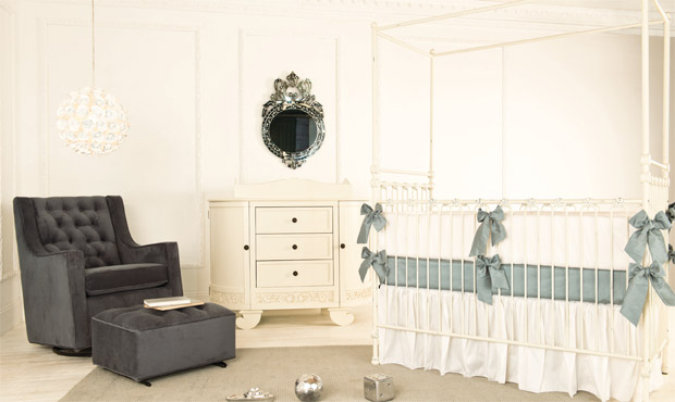 This refined space is the epitome of royal grace. The sharp and sophisticated color palette gives this nursery a regal charm.