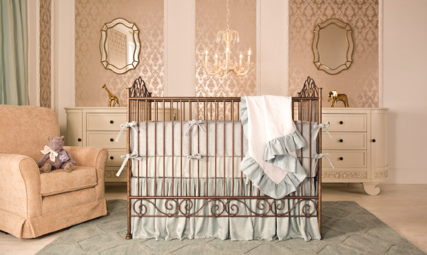The nursery is defined by its subtle and relaxed elegance and is perfect for a boy or girl. We love the cool tones in the bedding, rug, and window treatments singing against the warm metallic golds.