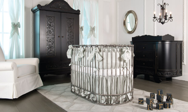 Quiet hues and the luxurious round iron crib define this beautiful baby room. This nursery will never go out of style and always whispers style and magic.