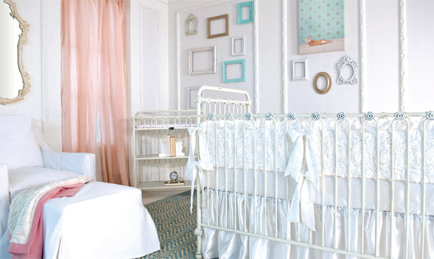 This light and airy nursery maximizes pure, soothing white space while creating excitement with pops of pink and tiffany blue. The beautiful mirror and sheer linen curtains add to the sense of vintage elegance throughout.