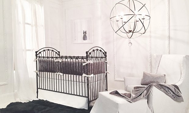This all white nursery with plush gray accents is the epitome of neutral elegance. The velvet bedding works beautiful with the deep gray sheep skin rug, adding rich texture. The oversized round chandelier makes an airy statement.