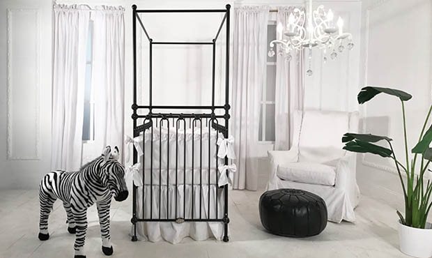 This sparse contemporary nursery is everything. The bold black four poster crib adds majesty to the otherwise white space. The minimalistic look feel is perfectly balanced while the deep green leafy plant brings life. Exquisite space for your baby boy or girl.