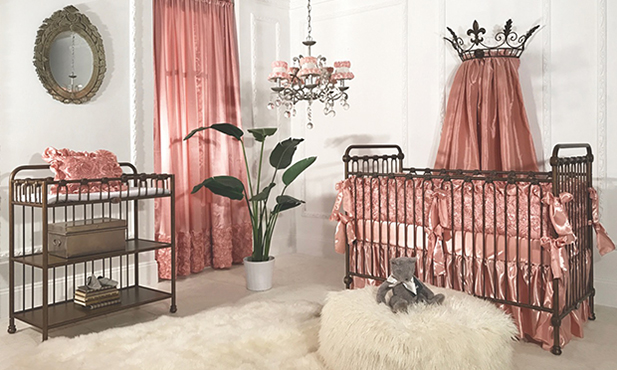Bring the beauty of a rose garden into your nursery.  The silky pink roses work their magic in this simple yet sophisticated baby space. Paired with the furry texture of the rug and pouf, and this space beacons one to come and luxuriate.