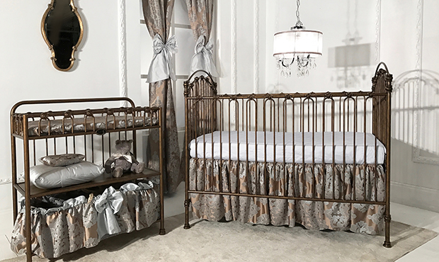 From the delicate fleur di lis castings found on the heirloom iron crib to the royal gold and silver mist silken bedding, this room gives a nod to the sun King. Elegant and timeless this entire nursery is perfect for your little prince