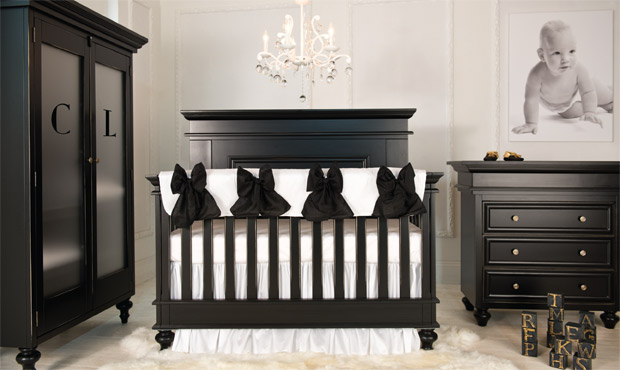 Maybe the most elegant neutral nursery of all time.  The black furnishings set in an all white space are not too heavy and even minimalistic.  This space is stark, sophisticated, modern and perfectly appointed. This crib also converts to a full bed!