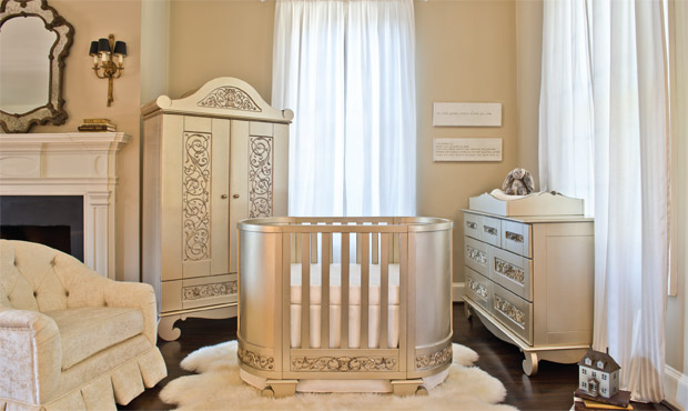 The jewel of this nursery is by far the delightfully carved darling crib. Silver, white, and shades of cream excite in this space along with the abundance of texture and pattern.