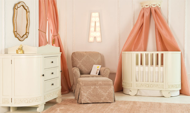 Unexpected and fun, this beautiful little nursery is both opulent and playful. The use of the color coral is less expected for a little girl's room, but equally as feminine.