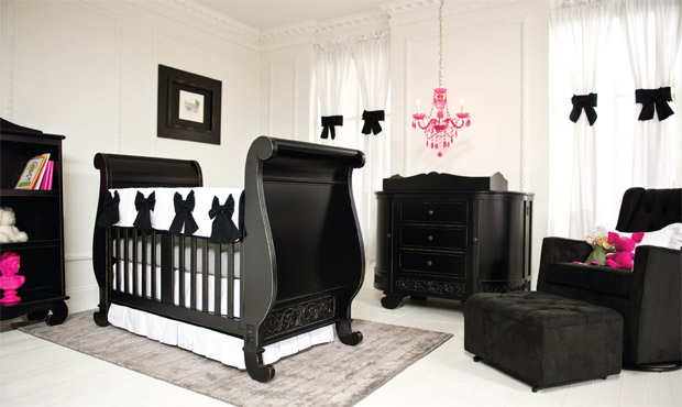 Black and white is a sophisticated color choice for your nursery. Add fun and whimsy with pops of hot pink throughout. The black bowed bedding & curtains button up this nursery to perfection.