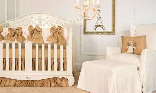 This gorgeous yet simple nursery borrows from the French king, Louis XIV, by boasting delicate golden embroidered fleur-de-lys throughout the bedding.