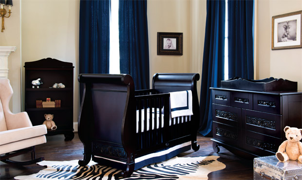 The deep, rich wood is grand in scale and timeless in beauty in this classic nursery. The navy accents and zebra print rug give one a feeling of gazing at the deep blue ocean from an African outpost.